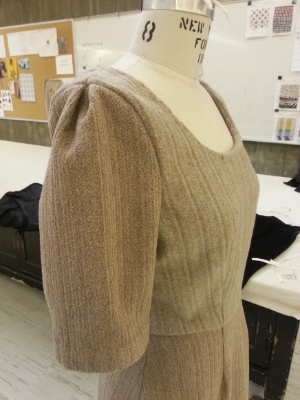 Closeup of puff sleeve on felted dress.