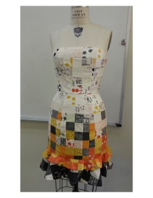 """This bustier was draped, designed, and sewn as a final Apparel Design project. I aimed to created a gradient in the patchwork from hem to top. The patchwork was done in 2.5"""" squares and 2.5"""" x 5"""" rectangles."""