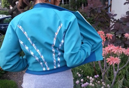 Wool and Rayon lined jacket with appliqué.